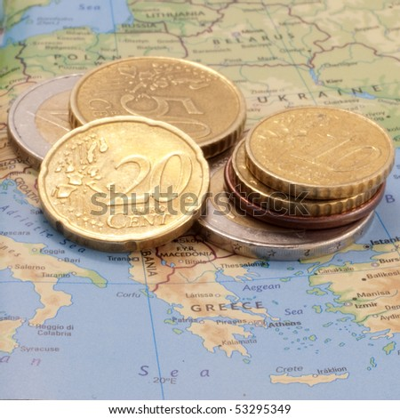 Map of Europe showing Greece and a stack of Euro coins - stock photo