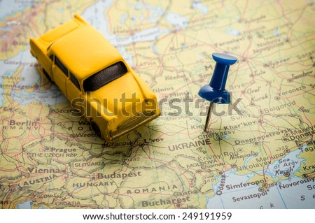 Map of Europe with a red push pin placed on the city of Kyiv. - stock photo