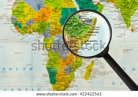 Map of Federal Republic of Somalia through magnigying glass - stock photo