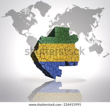 Map of Gabon with Gabonese Flag on a world map background - stock photo