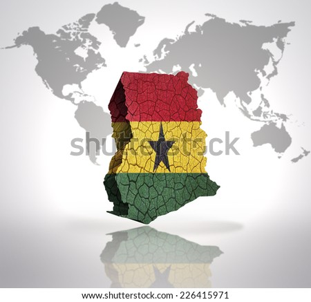 Map of Ghana with Ghanaian Flag on a world map background - stock photo