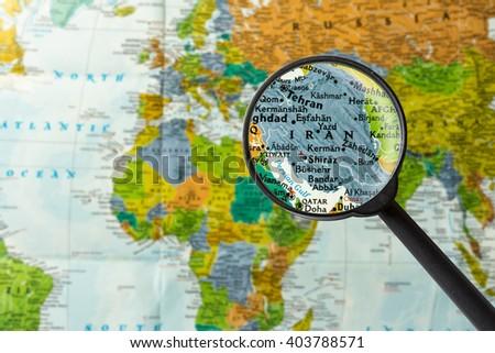 Map of Iran through magnifying glass - stock photo