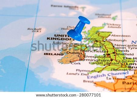 Map of Ireland with a blue pushpin stuck - stock photo