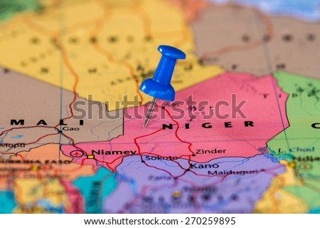 Map of Niger with a blue pushpin stuck - stock photo
