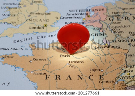 map of parisred map pointer stuck into of france