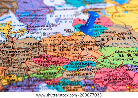Map of Poland with a blue pushpin stuck - stock photo