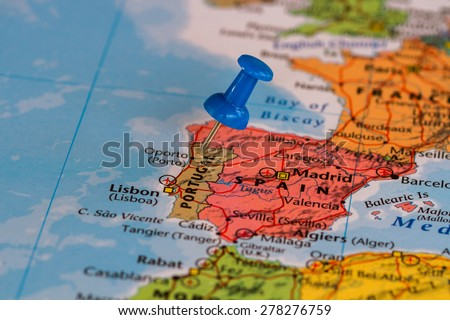 Map of Portugal  with a blue pushpin stuck - stock photo