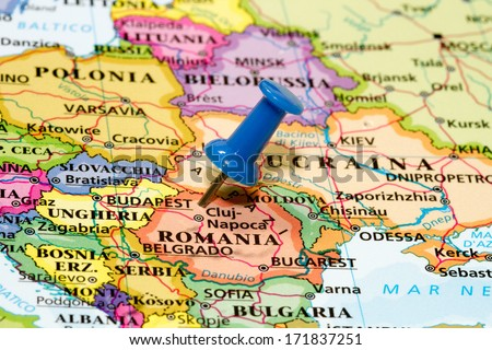 Map of Romania with a blue pushpin stuck - stock photo