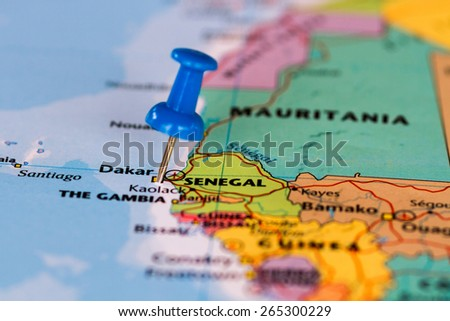 Map of Senegal with a blue pushpin stuck - stock photo