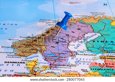 Map of Sweden with a blue pushpin stuck - stock photo