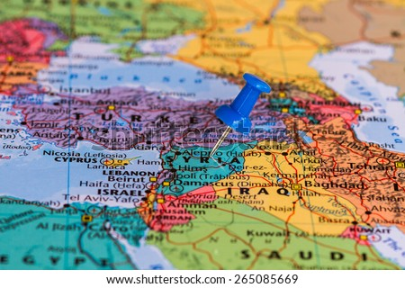 Map of Syria with a blue pushpin stuck - stock photo