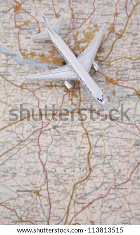 map of the city with plane - stock photo