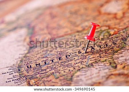 Map of USA with a red pushpin stuck - stock photo