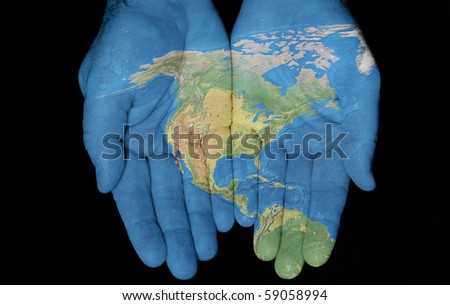 Map painted on hands showing concept of having North America in our hands - stock photo