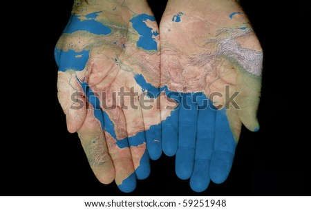 Map painted on hands showing concept of having the Middle East in our hands - stock photo