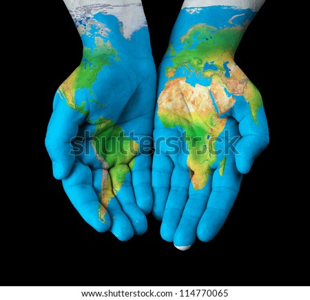 Map painted on hands showing concept of having the world in our hands - stock photo