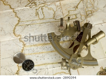 Map, sextant and compass - stock photo