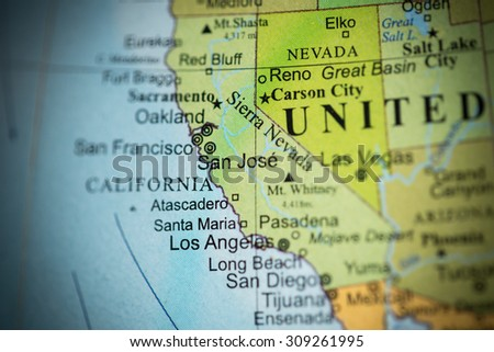 Map view of California on a geographical globe. (vignette) - stock photo