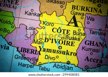 Map view of Ivory Coast on a geographical globe. (vignette)