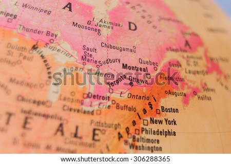 Map view of Montreal on a geographical globe - stock photo