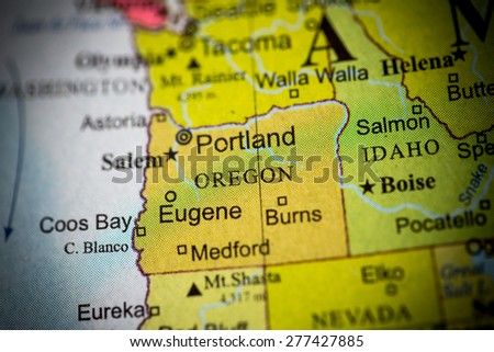 Map view of Portland on a geographical globe. (vignette) - stock photo