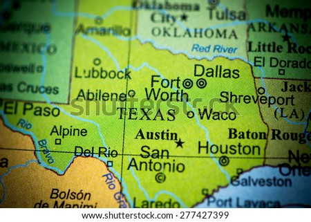 Map view of Texas on a geographical globe. (vignette) - stock photo