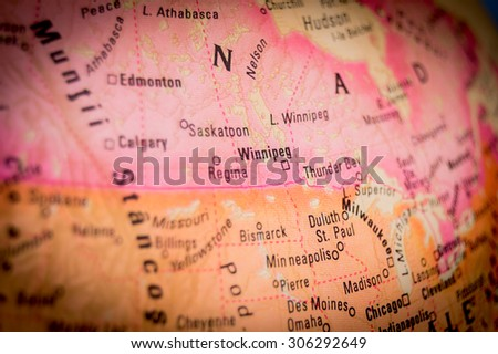 Map view of Winnipeg on a geographical globe. (vignette) - stock photo