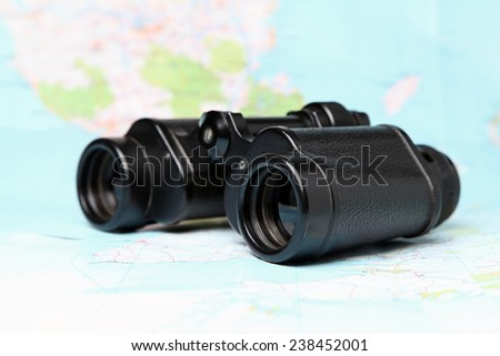 Map with Telescope - stock photo