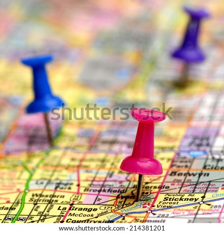 Map with thumb tacks showing locations - stock photo