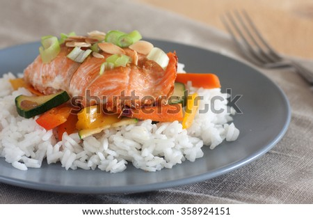 Maple glazed salmon with stir-fry vegetables and rice - stock photo