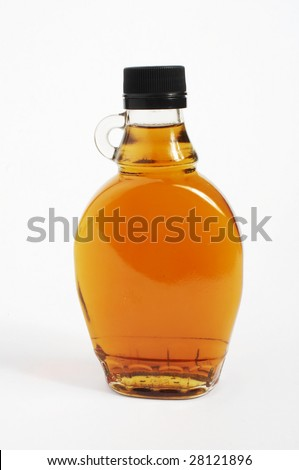Maple syrup in a glass bottle on a white background - stock photo