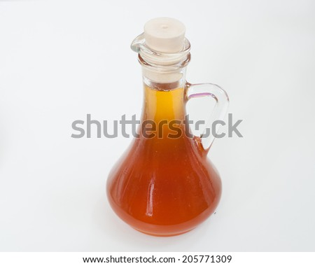 maple syrup in glass bottle - stock photo