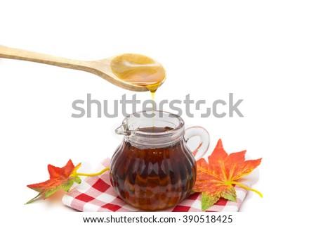 Maple syrup isolated on white background - stock photo