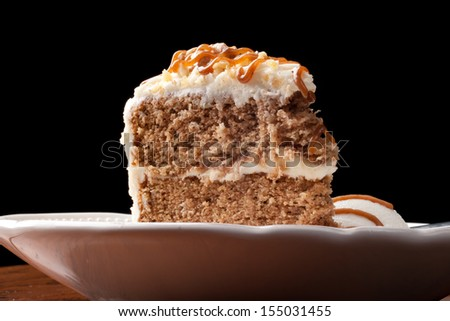 Maple Walnut Cinnamon Cake with vanilla ice cream on black background - stock photo
