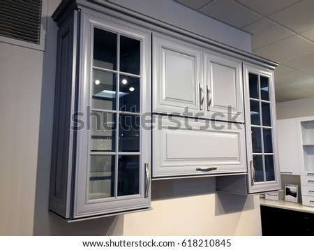 maple wood kitchen wall cabinets with glass doors crown molding and polished chrome hardware