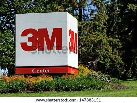 MAPLEWOOD, MN � MAY 31: A sign in front of the 3M World Headquarters complex on May 31, 2013. 3M is an American multinational conglomerate corporation primarily known for adhesive related products. - stock photo