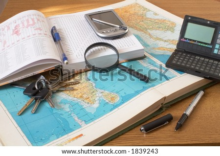 maps diary magnifier bunch of keys and pens - stock photo