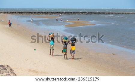 Maputo - Nov 27: The local residents of Maputo collect shellfish along the beach of Maputo Bay - Maputo, Mozambique, November 27, 2014 - stock photo