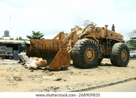 MAR 29, 2007 LAGOS, NIGERIA Street view, loader on road with garbage - stock photo