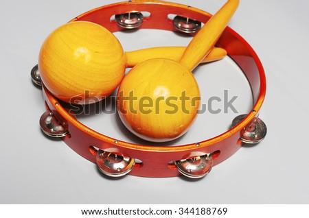 Maracas amd tambourine - stock photo