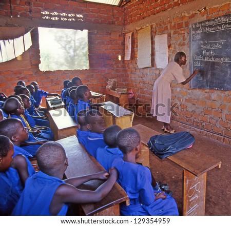 MARANATHA, UGANDA - JULY 26: unidentified children in Village school on July 26, 2004 in Maranatha village, Buikwe region, Uganda. Most children can walk to school thanks to foreign charity - stock photo