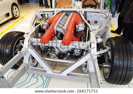 MARANELLO , ITALY - 5 APRIL 2015 : Details of the chassis of a Ferrari on display inside the Ferrari museum . The museum is very popular and has become the main attraction of the city