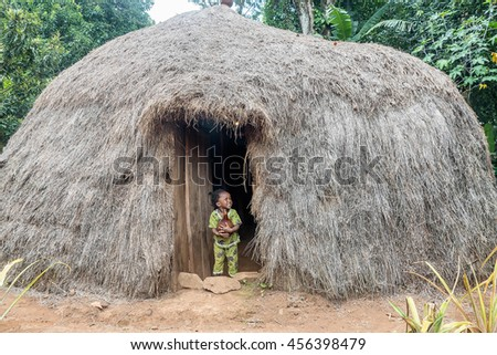 Marangu Village, Tanzania- March 23, 2016:Little girl standing by the door of Chagga-Masai tribe Hut in Marangu Village,  Tanzania