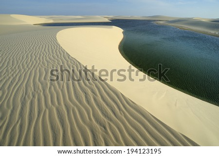 Maranhao state, Brazil -August. 21. 2010 : Lencois Maranhenses National Park,Brazil, low, flat, occasionally flooded land, overlaid with large, discrete sand dunes with blue and green lagoons - stock photo