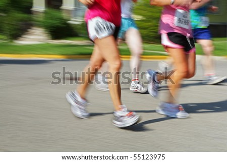 Marathon (motion blur) bib numbers have been changed - stock photo