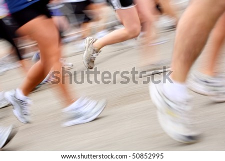 Marathon runners (in camera motion blur) - stock photo