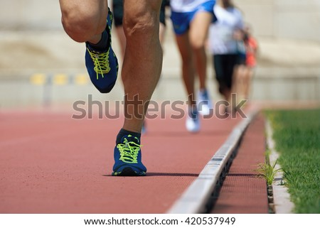Marathon runners.Marathon with the aim of the stadium,running on the athletics track - stock photo