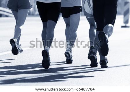 Marathon runners. Sport, competition, energy. - stock photo