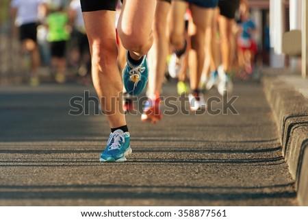 Marathon running in the light of evening - stock photo