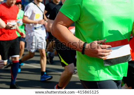 Marathon running race, runners on road, sport, fitness and healthy lifestyle concept  - stock photo